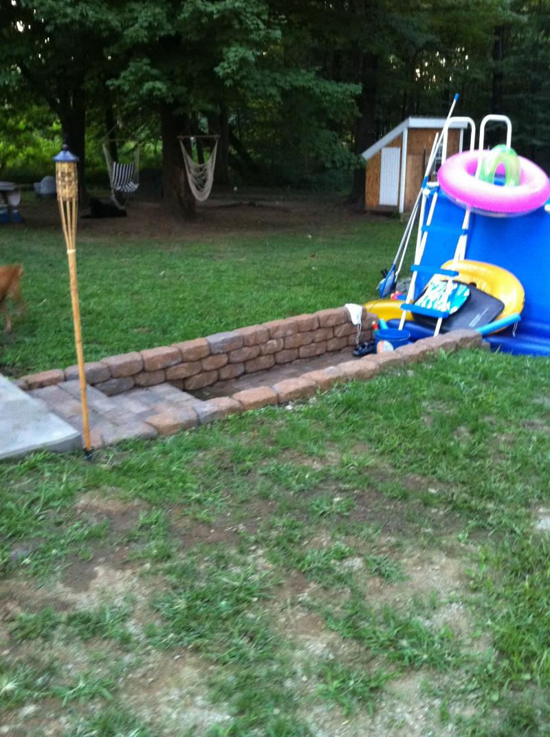Two steps, retaining wall, and path to pool