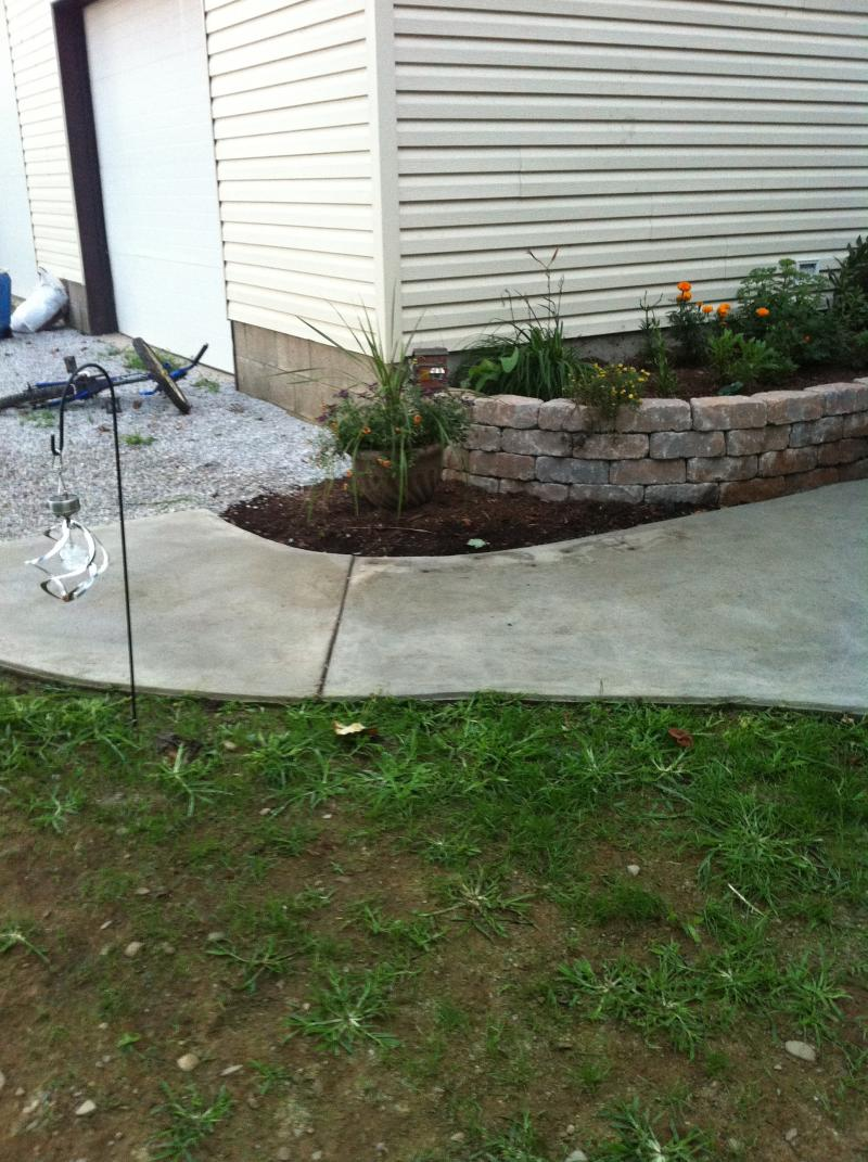 curved sidewalk from driveway to patio