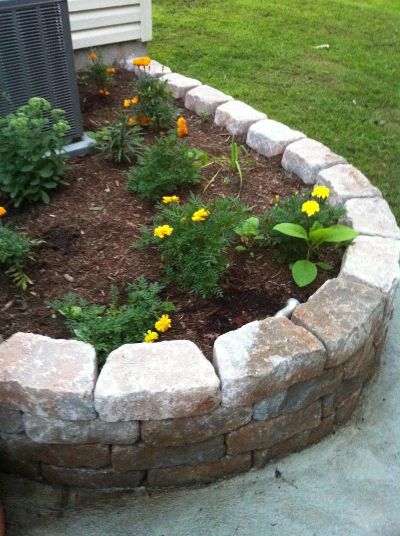 curved retaining wall flowerbed